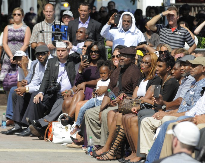 Friends and family of former Baltimore Ravens' Ray Lewis gathered to watch the unveiling of a bronze statue of Lewis outside M&T Bank Stadium. (Lloyd Fox/Baltimore Sun)