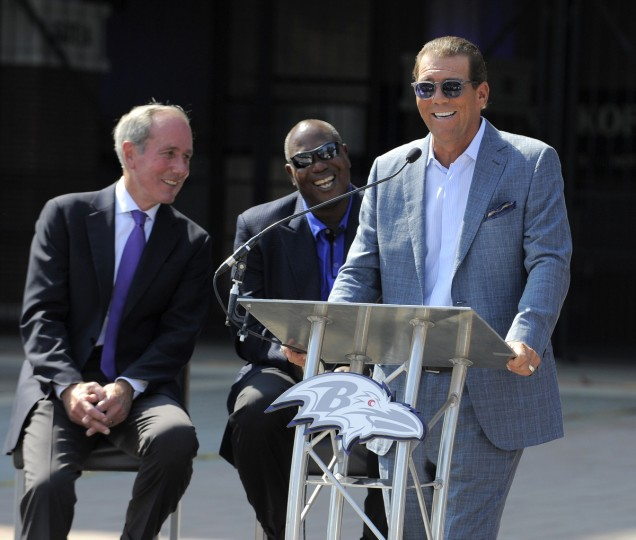 L-R Dick Cass and Ozzie Newsome listen to Baltimore Ravens' Owner Steve Bisciotti speak about Ray Lewis. (Lloyd Fox/Baltimore Sun)
