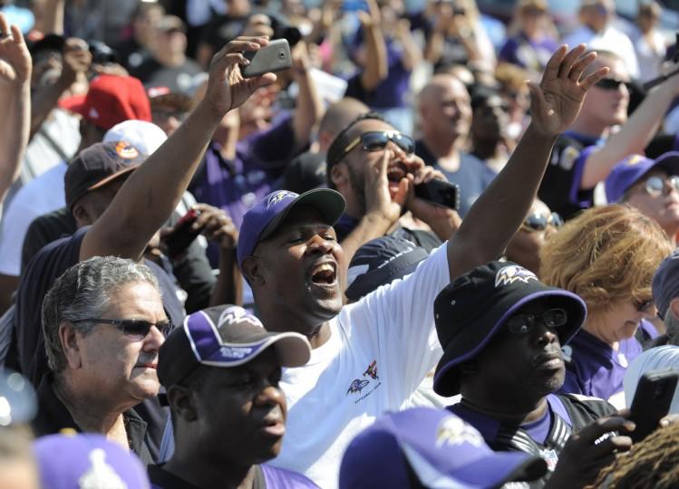 Baltimore Ravens unveil the bronze Ray Lewis statue outside of M&T Bank Stadium. (Lloyd Fox/Baltimore Sun)