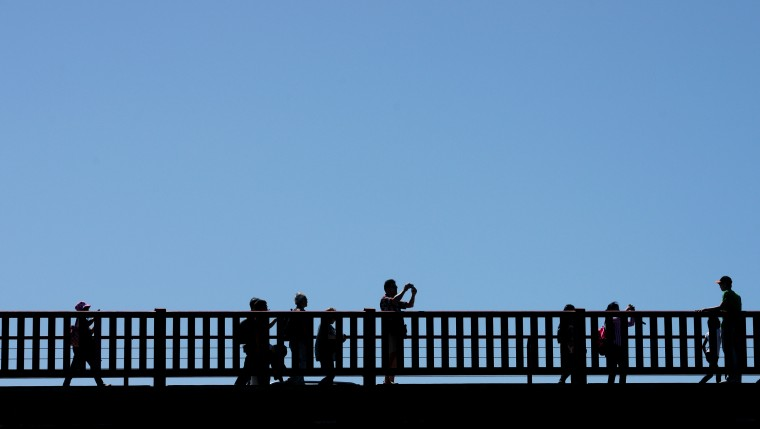 People photograph the Golden Gate Bridge on the San Francisco side.