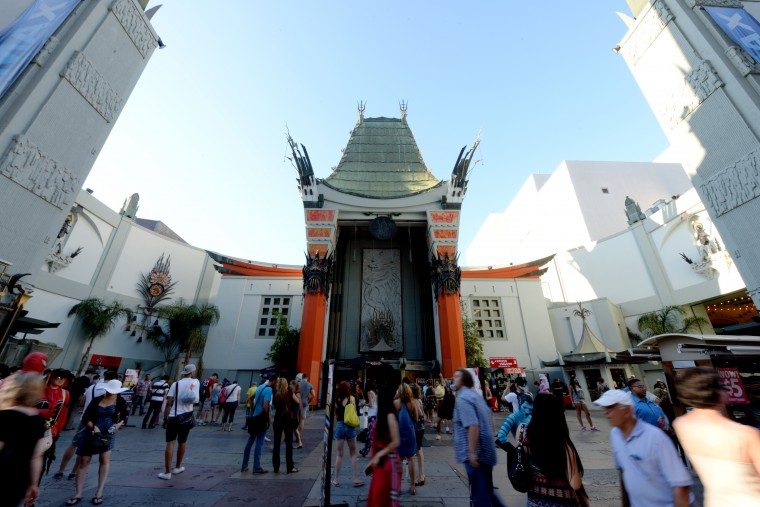 The TCL Chinese Theatre in Hollywood is bustling with tourists and street performers wearing movie costumes on Tuesday afternoon, Aug. 26.