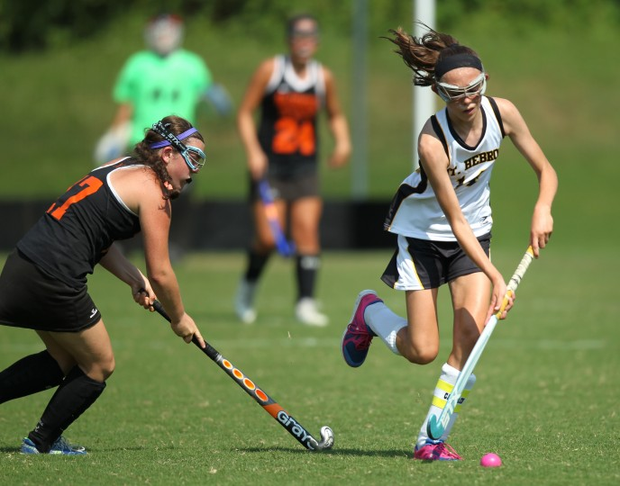 Mt. Hebron's Ally Unkenholz, right, controls the ball during the championship game of the MT. Hebron field hockey tournament against McDonogh at Mt. Hebron High School in Ellicott City on Saturday, Sept. 6, 2014. (Jen Rynda/BSMG)