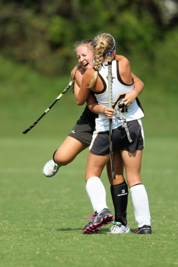 McDonogh's Madison Blair, left, and Mt. Hebron's Natalie Fyock, right, hug after the championship game of the MT. Hebron field hockey tournament at Mt. Hebron High School in Ellicott City on Saturday, Sept. 6, 2014. (Jen Rynda/BSMG)