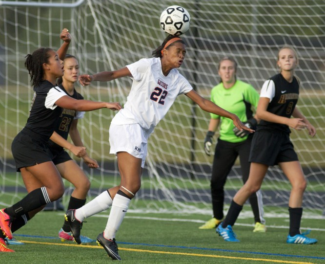 Reservoir's Kayla Pindell gets her head on the ball during the girls soccer game against Hammond at Reservoir High School in Fulton on Monday, September 22, 2014. (Jen Rynda/BSMG)