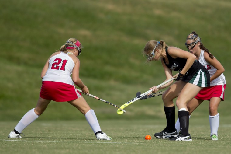 Glenelg's Paige Reese and Atholton's Tori Raulin get their sticks locked while going for the ball during the field hockey game at Glenelg High School in Glenelg on Tuesday, September 23, 2014. (Jen Rynda/BSMG)