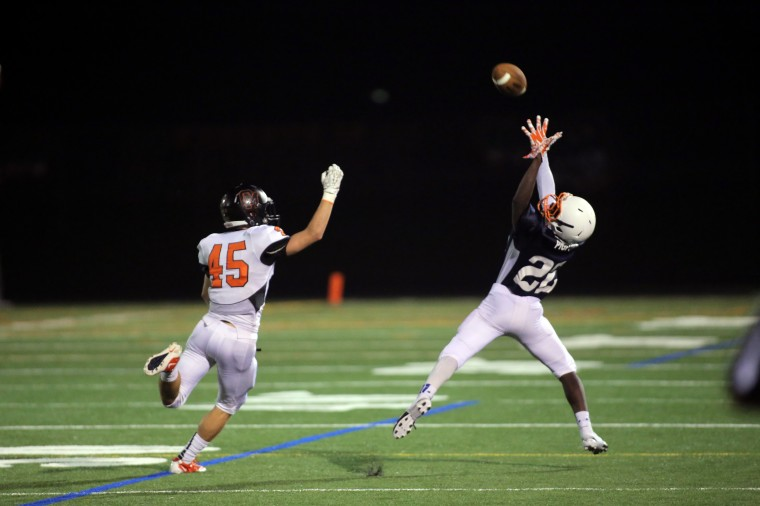 Reservoir's John Pigford, right, leaps to catch a pass during their 41-32 loss to Oakland Mills on Friday, Sept. 26th. (James Levin/BSMG)