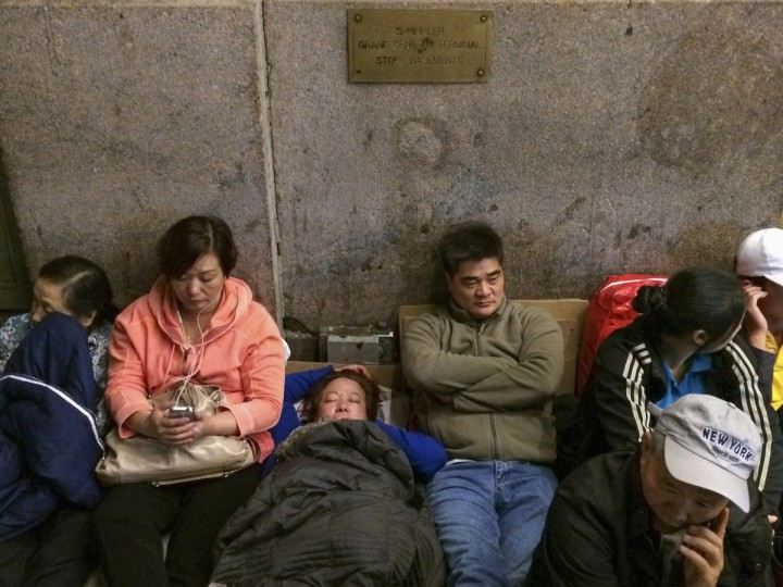 Customers wait in line on the first day of sale for the iPhone 6 and iPhone 6 Plus outside the Apple store at Grand Central Terminal in New York September 18, 2014. Adrees Latif/Reuters photo