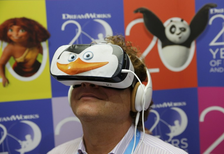 A visitor tries the new Samsung Gear VR device at the IFA consumer technology fair in Berlin, September 5, 2014. (Fabrizio Bensch/Reuters)