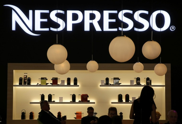Visitors take a pause at the booth of Nespresso at the IFA consumer technology fair in Berlin, September 5, 2014. Sony camera lenses with attached lens-like cameras ILCE-QX1 with 20.1MP sensors are pictured at the IFA consumer technology fair in Berlin, September 5, 2014. (Fabrizio Bensch/Reuters)