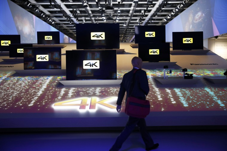 A visitor walks past 4k-capable screens at the booth of Panasonic during the IFA Electronics show in Berlin, September 5, 2014. A visitor looks at Panasonic washing machines during the IFA consumer technology fair in Berlin, September 5, 2014. (Fabrizio Bensch/Reuters)