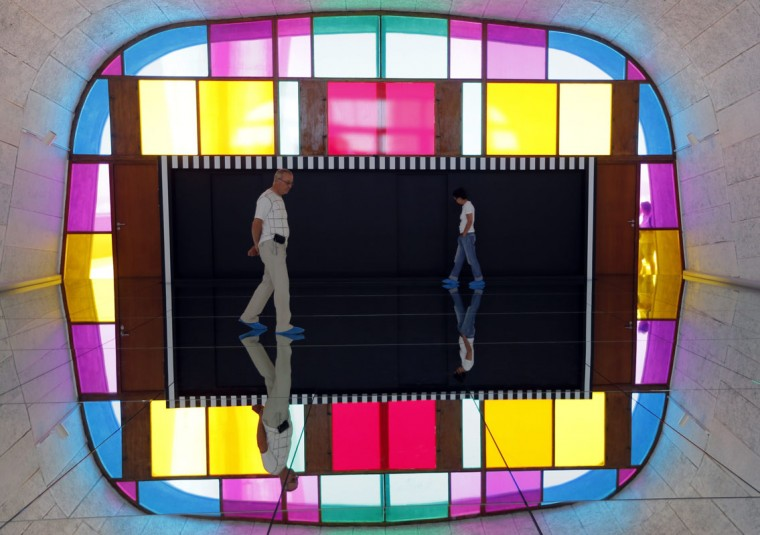 """Visitors walk on a creation by French artist Daniel Buren as part of his exhibition """"Defini Fini Infini, Travaux in situ"""" at the MaMo art center in Marseille September 12, 2014. The MaMo contemporary art center is installed on the restored rooftop terrace of Le Corbusier's 1947 Cite Radieuse (Radiant City) and created by French designer Ora-Ito. (Photos by Jean-Paul Pelissier/Reuters)"""