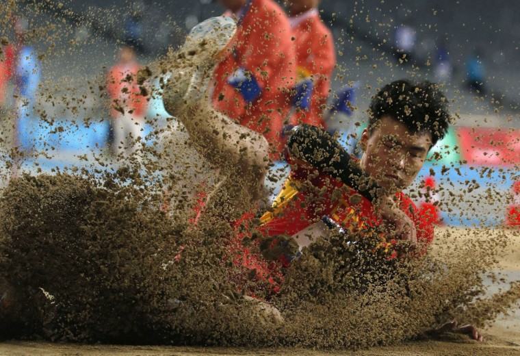 China's Li Jinzhe competes in the men's long jump final at the Incheon Asiad Main Stadium during the 17th Asian Games September 30, 2014. (REUTERS/Jason Reed)