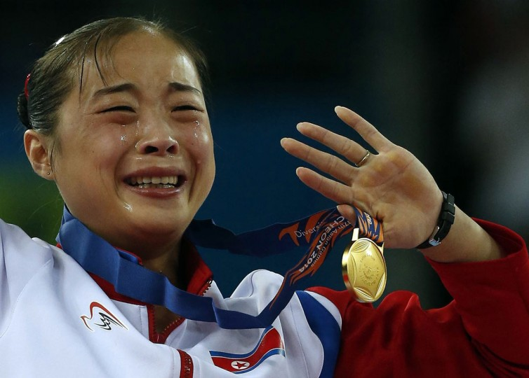North Korea's gold medallist Kim Un Hyang cries during the medal ceremony for the women's beam final of the artistic gymnastics competition at the Namdong Gymnasium Club during the 17th Asian Games in Incheon September 25, 2014. (REUTERS/Jason Reed)