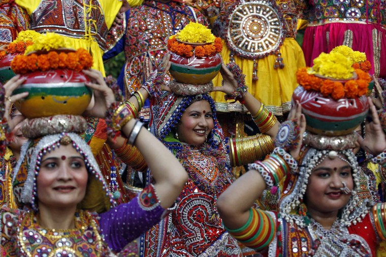 "Women dressed in traditional attire pose as they take part in rehearsals for the ""garba"" dance ahead of Navratri festival in the western Indian city of Ahmedabad. Navratri, held in honour of Hindu Goddess Durga, is celebrated over a period of nine days where thousands of youths dance the night away in traditional costumes. Navratri starts on September 25. (Amit Dave/Reuters)"
