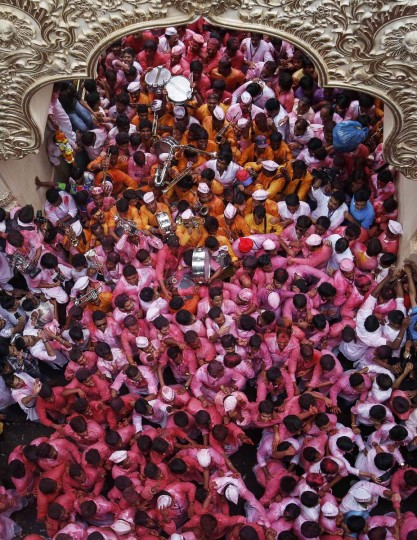 Devotees celebrate as they take out an idol of Hindu elephant god Ganesh, the deity of prosperity, from a place worship during a procession through the streets before immersing it in the waters of the Arabian Sea on the last day of the Ganesh Chaturthi festival in Mumbai September 8, 2014. Ganesh idols are taken through the streets in a procession accompanied by dancing and singing, and later immersed in a river or the sea, symbolising a ritual seeing-off of his journey towards his abode, taking away with him the misfortunes of all mankind. (Danish Siddiqui/Reuters)