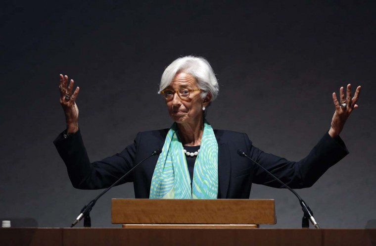 International Monetary Fund Managing Director Christine Lagarde gestures as she gives a speech during the World Assembly for Women (WAW! Tokyo 2014) in Tokyo September 12. Japanese Prime Minister Shinzo Abe's targets for empowering women, a key part of his economic growth strategy, could add substantially to annual growth if met, Lagarde said on Friday.   || PHOTO CREDIT: YUYA SHINO  - REUTERS
