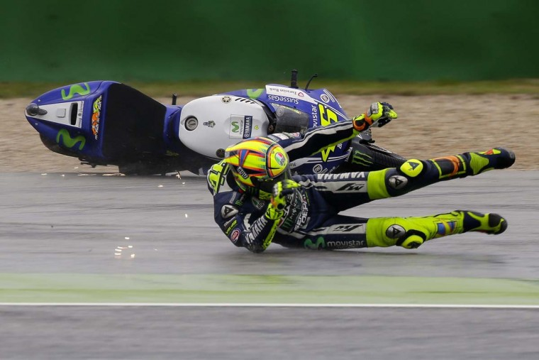Yamaha MotoGP rider Valentino Rossi of Italy crashes during the first free practice session of the Italian Grand Prix at the Misano Adriatico circuit in central Italy September 12.  || PHOTO CREDIT: MAX ROSSI  - REUTERS