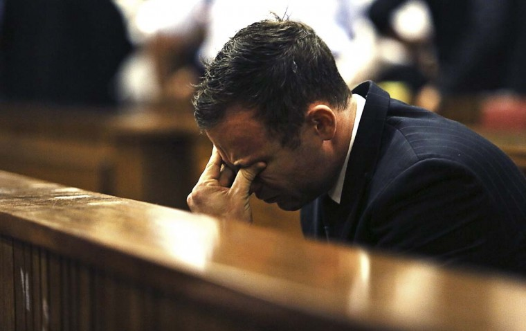 Olympic and Paralympic track star Oscar Pistorius reacts as Judge Thokozile Masipa (unseen) delivers her verdict at the North Gauteng High Court in Pretoria September 12. Pistorius was convicted of culpable homicide on Friday, escaping the more serious charge of murder for the killing of his girlfriend, Reeva Steenkamp, and will now battle to avoid going to prison.  || PHOTO CREDIT: ALON SKUY/POOL  - REUTERS