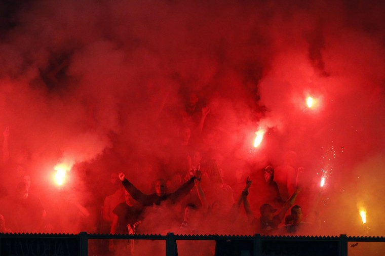 Maribor fans light flares as they celebrate the goal by Damjan Bohar against Schalke 04 during their Champions League group G soccer match in Gelsenkirchen September 30, 2014. (REUTERS/Wolfgang Rattay)