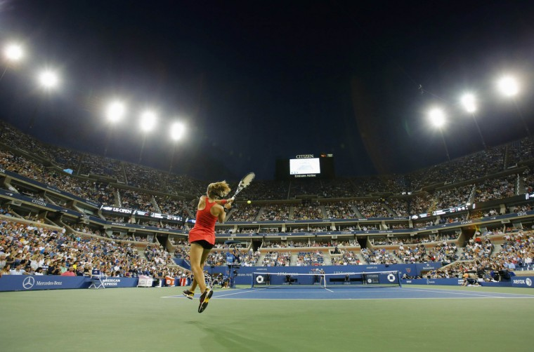 Aleksandra Krunic of Serbia returns a shot to Victoria Azarenka of Belarus during their women's singles match at the 2014 U.S. Open tennis tournament in New York, September 1, 2014. (REUTERS/Adam Hunger)