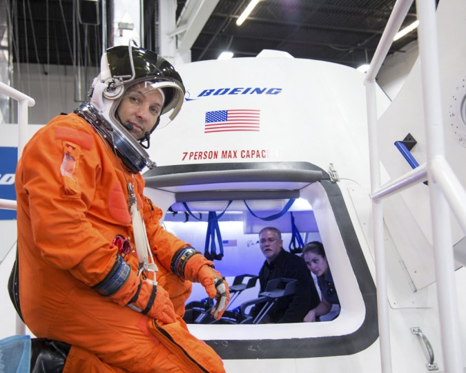 "NASA astronaut Randy Bresnik prepares to enter Boeing's CST-100 spacecraft for a fit check evaluation at the company's Houston Product Support Center in this undated image. NASA will partner with Boeing and SpaceX to build commercially owned and operated ""space taxis"" to fly astronauts to the International Space Station, ending U.S. dependence on Russia for rides, officials said on Tuesday. (NASA/Handout via Reuters/Reuters)"