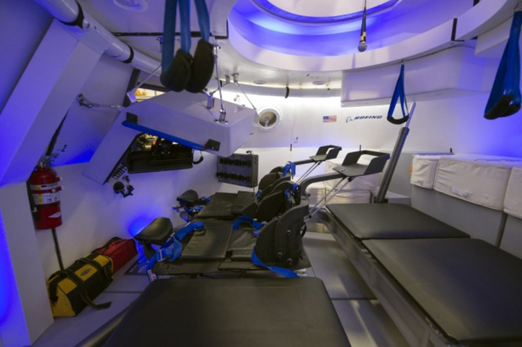 "An interior view of Boeing's CST-100 spacecraft, which features LED lighting and tablet technology, is seen in an undated NASA handout image. NASA will partner with Boeing and SpaceX to build commercially owned and operated ""space taxis"" to fly astronauts to the International Space Station, ending U.S. dependence on Russia for rides, officials said on Tuesday. (NASA/Robert Markowitz/Handout /Reuters)"