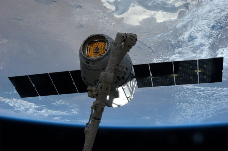 "The SpaceX Dragon commercial cargo spacecraft is grappled to Canadarm2 at the International Space Station in this NASA picture taken April 20, 2014. NASA will partner with Boeing and SpaceX to building commercially owned and operated ""space taxis"" that would fly astronauts to the International Space Station ending U.S. Dependence on Russia for rides, U.S. Senator Bill Nelson said September 16, 2014. (NASA/Handout via Reuters/Reuters)"