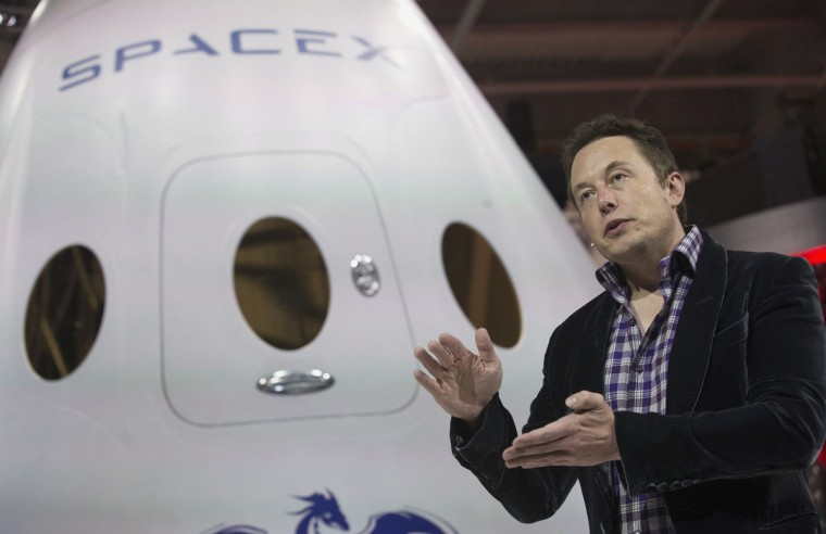 "SpaceX CEO Elon Musk speaks after unveiling the Dragon V2 spacecraft in Hawthorne, California in this May 29, 2014 file photo. NASA will partner with Boeing and SpaceX to building commercially owned and operated ""space taxis"" that would fly astronauts to the International Space Station ending U.S. Dependence on Russia for rides, U.S. Senator Bill Nelson said September 16, 2014. (Mario Anzuoni/Files/Reuters)"