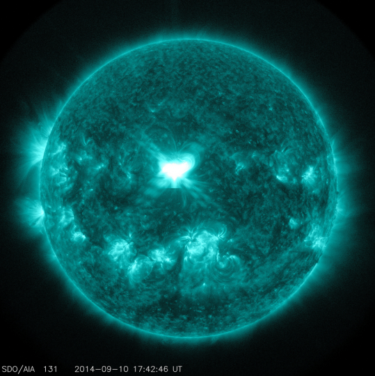 An X1.6 class solar flare flashes in the middle of the sun in this image taken September 10, 2014, in this image courtesy of NASA. This image was captured by NASA's Solar Dynamics Observatory and shows light in the 131 Angstrom wavelength, which is typically colorized in teal. A rare double burst of magnetically charged solar storms will hit Earth Thursday night and Friday, raising concerns that GPS signals, radio communications and power transmissions could be disrupted, officials said on September 11, 2014. (NASA)