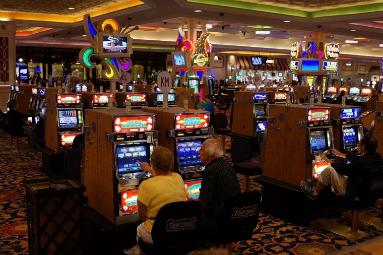 People gamble at the Showboat Casino, which was scheduled to close earlier this year, in Atlantic City on July 29, 2014 in Atlantic City, New Jersey. (Photo by Spencer Platt/Getty Images)