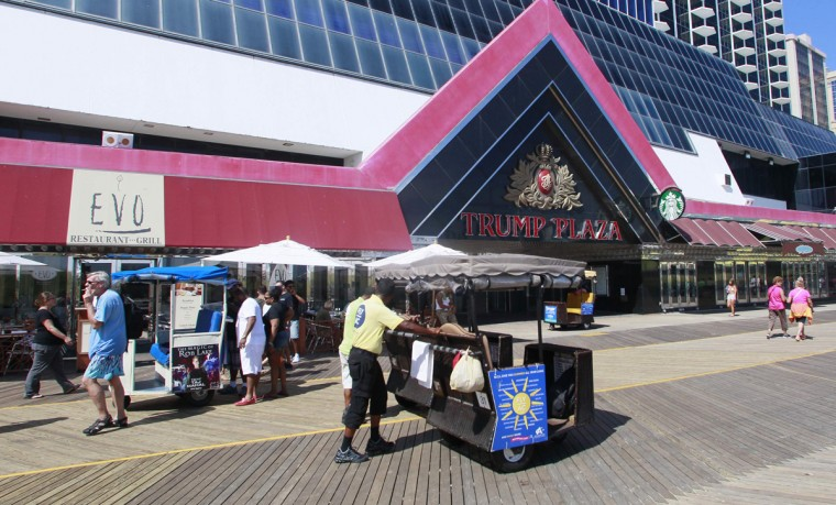 People walk on the boardwalk in front of the Trump Plaza Hotel and Casino in Atlantic City, New Jersey September 1, 2014. Four Atlantic City casinos are closing this year, but not all of their gamblers will return to visit eight others that have survived in the down-on-its-luck New Jersey resort. A third of Atlantic City's casinos have closed or soon plan to. The city's newest casino and arguably its biggest failure, the $2.4 billion Revel Casino Hotel, is in its second bankruptcy after opening in 2012. It closed on Tuesday. The Showboat Casino Hotel, a Caesars Entertainment Corp property, was shut down on Sunday morning, and Trump Plaza Hotel and Casino is due to close in mid-September. Atlantic Club Casino Hotel was shuttered in January. (Tom Mihalek/Reuters)