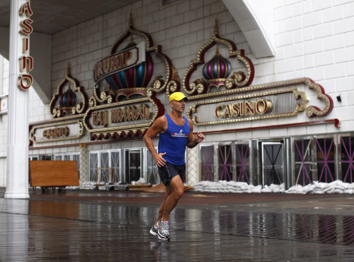 A jogger runs past the sandbagged and closed Trump Taj Mahal Casino on the boardwalk at Atlantic City, New Jersey in this file photo from August 27, 2011. (Jason Reed/Reuters)