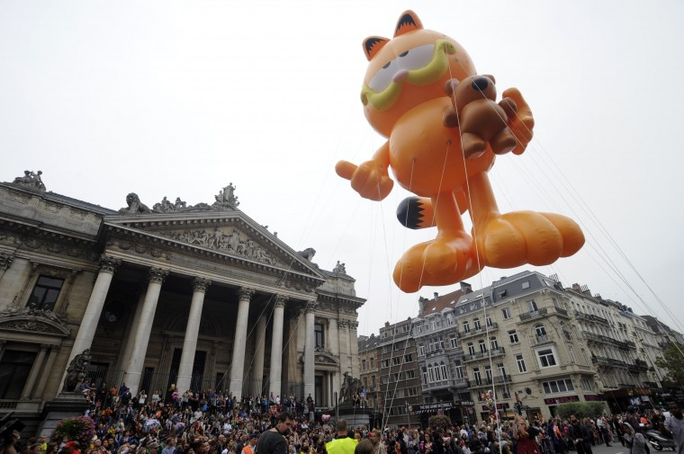 A Garfield balloon float makes its way in front of the Stock Exchange during the Balloon's Day Parade in Brussels. (/Eric Vidal/Reuters)