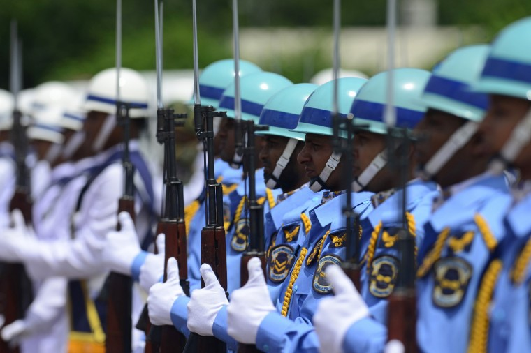 A Bangladeshi Guard of Honour stands in formation during Japanese Prime Minister Shinzo Abe's arrival at the Hazrat Shahjalal International Airport in Dhaka. Abe arrived in Dhaka for a three-day visit to Bangladesh and Sri Lanka aimed at offsetting China's mounting influence in South Asia. (Munir Uz Saman/AFP-Getty Images)