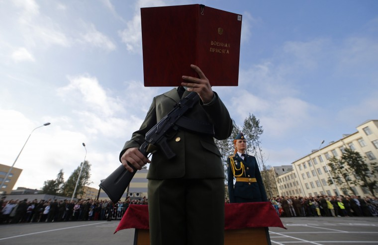 A first year cadet of the Military University of Communication takes the oath during a ceremony in St.Petersburg. Some 700 first year cadets of the academy attended the ceremony before starting their studies. (Alexander Demianchuk/REUTERS)