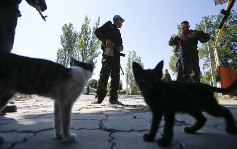 Pro-Russian separatists guard the area at a check point on the outskirts of Donetsk. An uneasy calm prevailed in eastern Ukraine on Saturday after Ukrainian forces and pro-Russian separatists signed a ceasefire as part of a drive to end a war that has triggered a deep crisis in relations between Russia and the West. (Maxim Shemetov/Reuters)