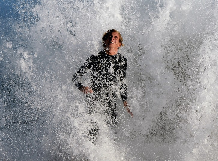 "A surfer wipes out after riding storm generated waves at ""The Wedge"" break in Newport Beach, California. The southern Californian coast is being hit by its second set of large swells in 10 days, this time being generated by Cyclone Norbert. (Mark Ralston/AFP-Getty Images)"