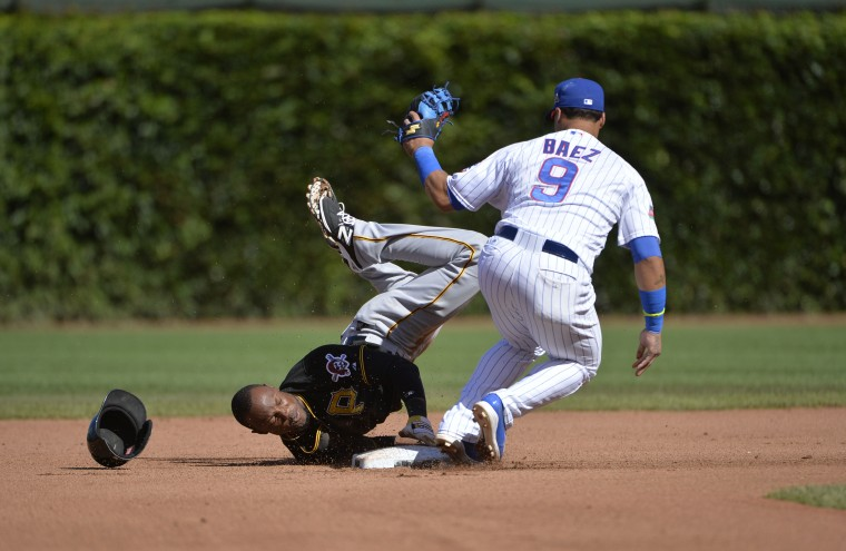 Second baseman Javier Baez #9 of the Chicago Cubs tags out Starling Marte #6 of the Pittsburgh Pirates as he tries to steal second base during the tenth inning at Wrigley Field in Chicago, Illinois. The game was the continuation of the previous day's game, which was suspended due to rain. (Brian Kersey/Getty Images)