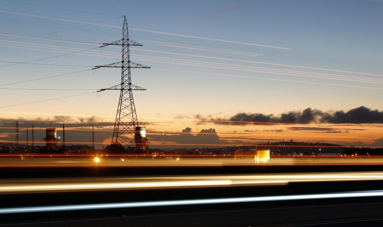 High-voltage power lines are seen next to the highway of Puchuncavi city, northwest of Santiago. Picture taken with slow shutter speed. (Eliseo Fernandez/Reuters)