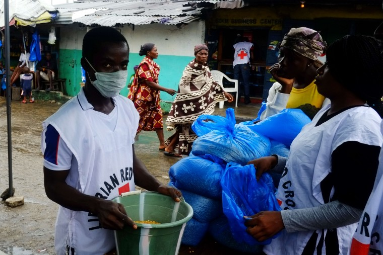 A Liberian Red Cross worker prepares bags of rice at a World Food Program (WFP) food distribution in Monrovia's West Point slum. The death toll from the Ebola epidemic has climbed above 2,000, the World Health Organisztion (WHO) said on September 5, as it voiced hopes a vaccine could be available in November. The deadly virus has claimed 2,097 lives out of 3,944 people infected in Liberia, Guinea and Sierra Leone, since emerging in December 2013, the UN's health organ said after a two-day crisis meeting in Geneva. (Dominique FagetAFP-Getty Images)
