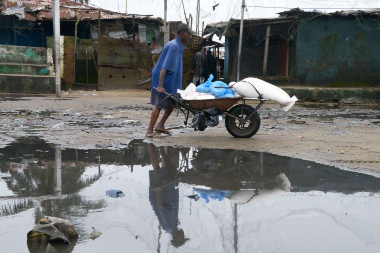 A man pushes a wheelbarrow filled with food during a World Food Program (WFP) food distribution in Monrovia's West Point slum The death toll from the Ebola epidemic has climbed above 2,000, the World Health Organisztion (WHO) said on September 5, as it voiced hopes a vaccine could be available in November. The deadly virus has claimed 2,097 lives out of 3,944 people infected in Liberia, Guinea and Sierra Leone, since emerging in December 2013, the UN's health organ said after a two-day crisis meeting in Geneva. (Dominique FagetAFP-Getty Images)