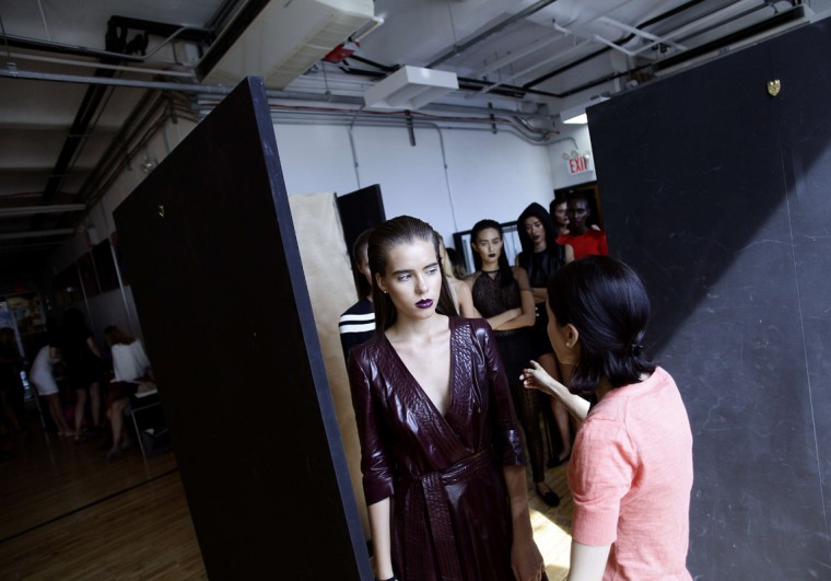 Models receive instructions backstage as they present creations from Alina German Spring/Summer 2015 collection during New York Fashion Week September 3, 2014 in New York. (Joshua Lott/AFP/Getty Images)