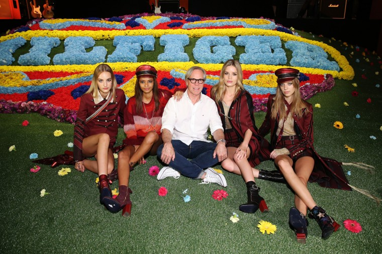 Tommy Hilfiger, Georgia May Jagger and models pose backstage at Tommy Hilfiger Women's fashion show during Mercedes-Benz Fashion Week Spring 2015 at Park Avenue Armory on September 8, 2014 in New York City. (Photo by Neilson Barnard/Getty Images for Tommy Hilfiger)