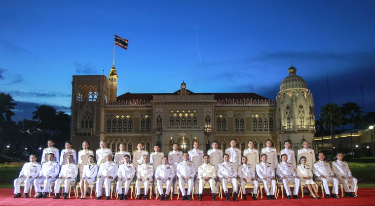 Thailand's Prime Minister Prayuth Chan-ocha (front row, C) and his cabinet pose during a photo session at Government House after an audience with King Bhumibol Adulyadej at Siriraj Hospital in Bangkok September 4, 2014. Thailand's new military-stacked cabinet met King Bhumibol in Bangkok on Thursday, marking the formal start of an administration that will spend at least a year overhauling the political system before calling an election. (Chaiwat subprasom/Reuters)