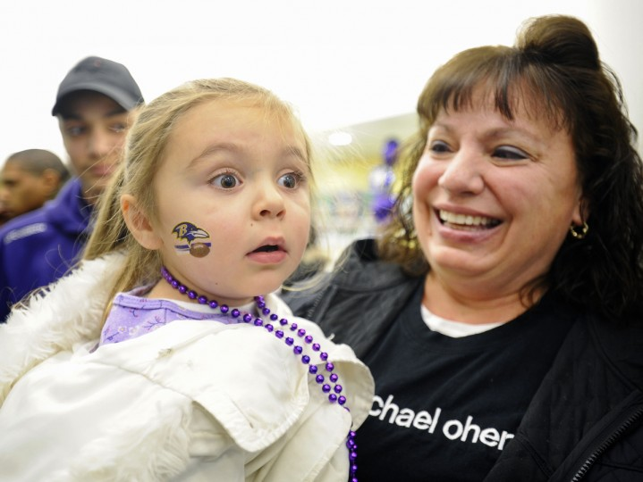"Tristen Rodriguez, left, of Essex, reacts as she sees Ravens mascot Poe appear for the ""Pound the Patriots"" rally at M&T Bank's flagship branch at 25 South Charles Street in January 2010. Rodriguez attended the rally with grandmother Linda Rode, right. (Kenneth K. Lam /Baltimore Sun)"