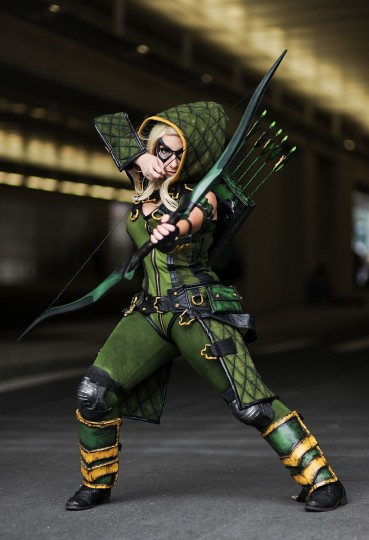 A Comic Con attendee poses as Arrow during the 2014 New York Comic Con at Jacob Javitz Center. Daniel Zuchnik/Getty Images