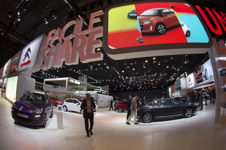 Visitors look at cars by French carmaker Citroen at the Paris Auto Show in Paris on October 2, 2014. Joel Saget/AFP/Getty Images