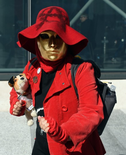 Fans in costume arrive for the opening session of the 2014 New York Comic Con at the Jacob Javits Center on October 9, 2014. The four day event which runs October 9-12 is the largest pop culture event on the East Coast. Timothy A. Clary/AFP/Getty Images