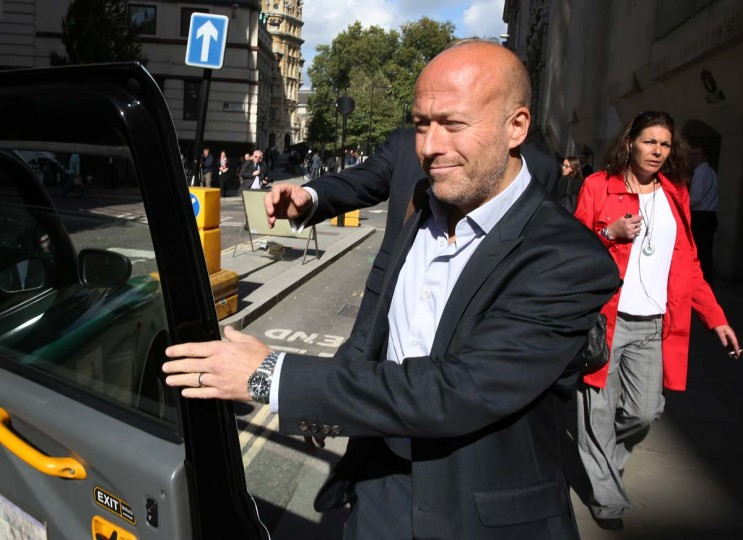 Former News of the World news editor Ian Edmondson leaves the Old Bailey on October 3 in London, England. Mr Edmondson has pleaded guilty to plotting to hack telephones in his time at the now closed tabloid newspaper.  ||Photo by Peter Macdiarmid/Getty Images