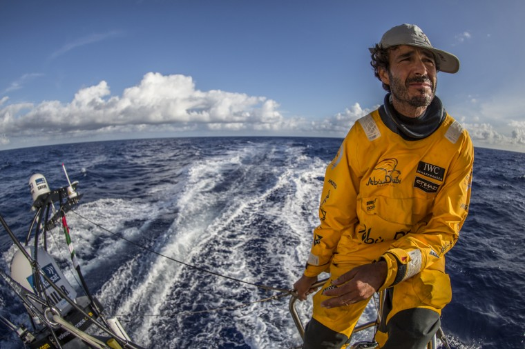 "Onboard Abu Dhabi Ocean Racing. Roberto Bermudez de Castro, aka Chuny, surveys the horizon from the stern of ""Azzam"" during Leg 1 between Alicante, Spain and Cape Town, South Africa. The Volvo Ocean Race 2014-15 is the 12th running of this ocean marathon. Starting from Alicante in Spain on October 11, 2014, the route, spanning some 39,379 nautical miles, visits 11 ports in 11 countries (Spain, South Africa, United Arab Emirates, China, New Zealand, Brazil, United States, Portugal, France, the Netherlands and Sweden) over nine months. The Volvo Ocean Race is the world's premier ocean race for professional racing crews. (Photo by Matt Knighton/Abu Dhabi Ocean Racing/Volvo Ocean Race via Getty Images)"
